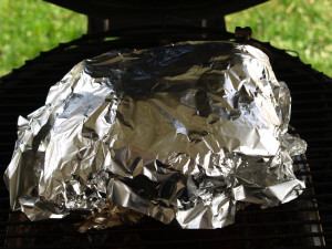 Wrapping the roast in tin foil to retain the moisture and help raise the temperature to195-205 degrees Fahrenheit.