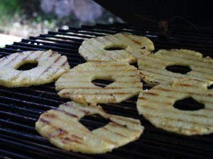 Grilling some fresh pineapple rings.