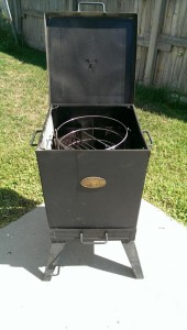 "This small smoker is about 14"" square and has a small charcoal basket in each corner. Works great!"